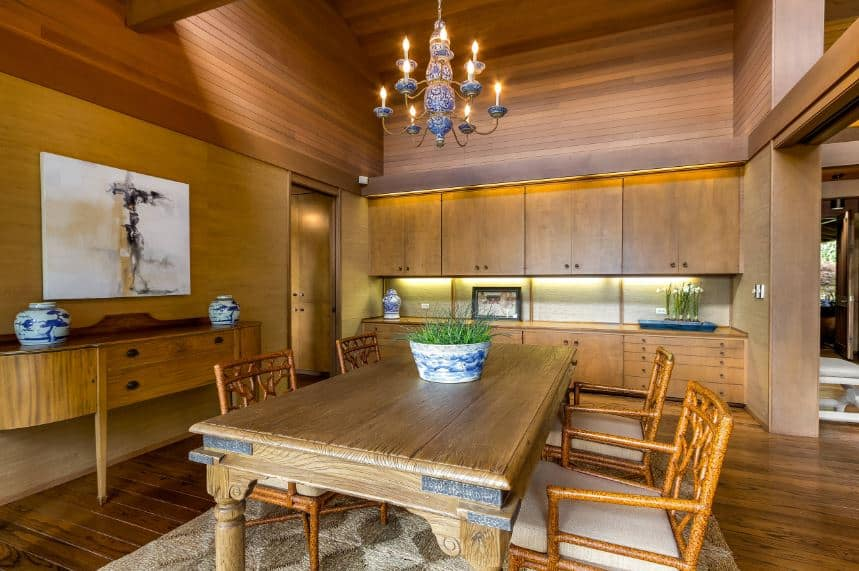 The amazing craftsmanship of the wooden elements of this dining room is astounding. The hardwood flooring, wooden walls and wooden ceiling are all made of wood but somehow looks different with a different shade of brown.
