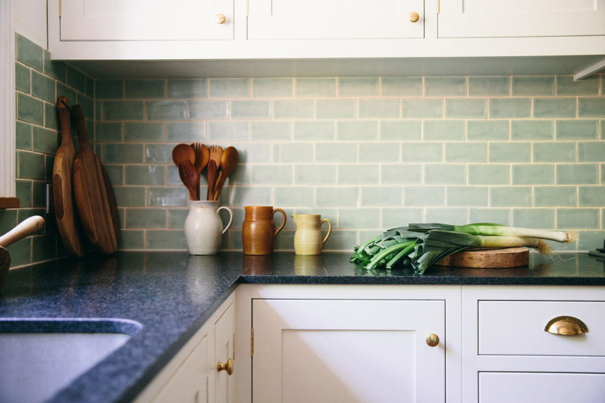 Kitchen surface with brass cabinet handles.