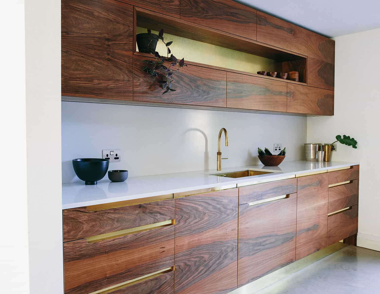 Walnut wood shaker kitchen cabinets.