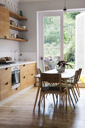 Bespoke kitchen with floating cherry shelves and veneered birch plywood pull-out cabinets under the worktop with routed handles.