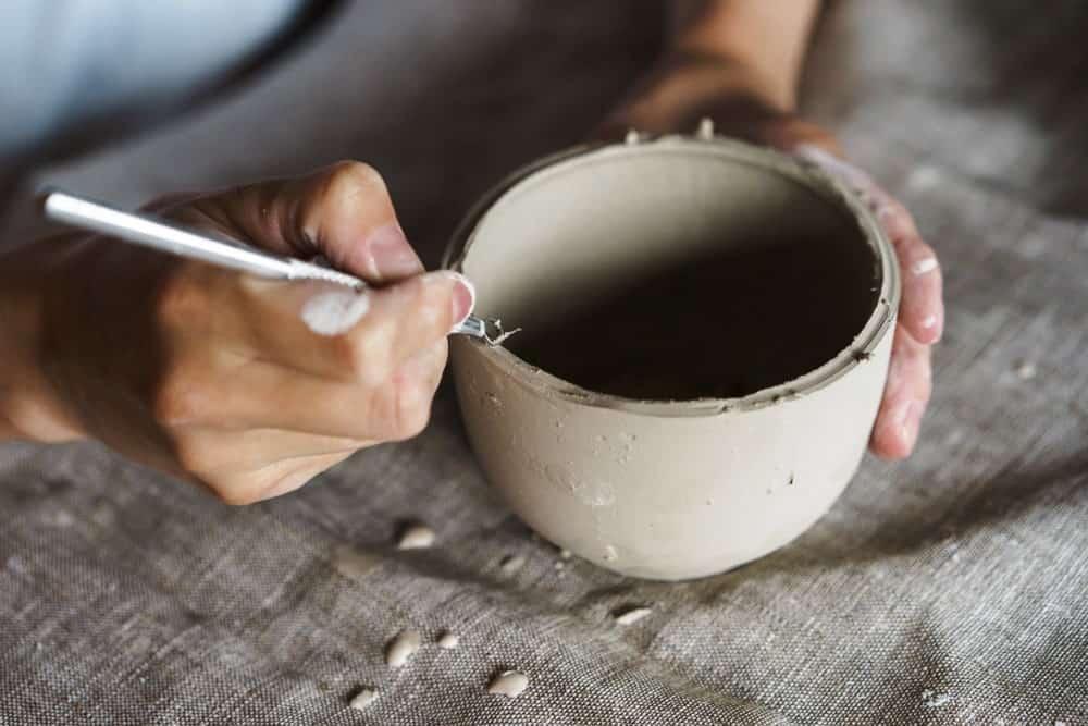 Casting a clay sculpture.