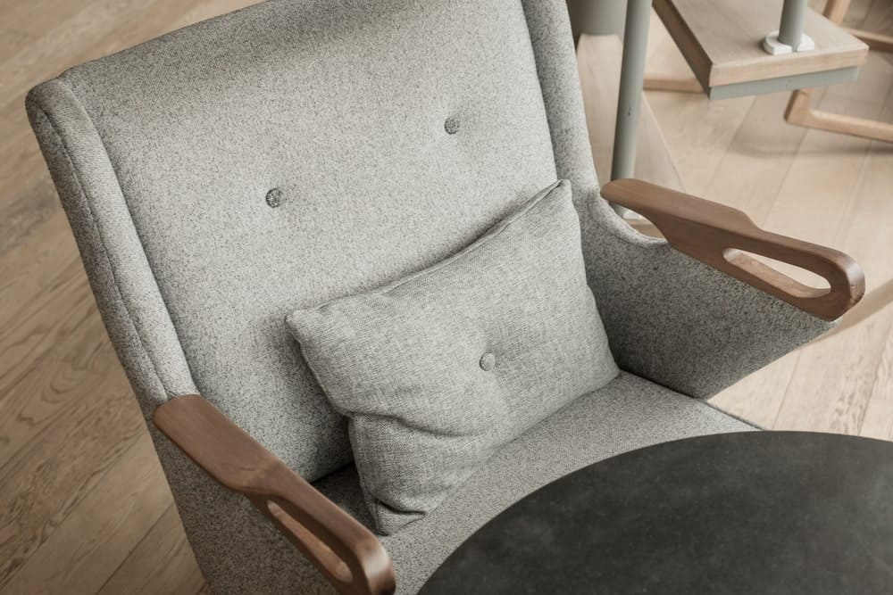 Closeup of an upholstered chair.