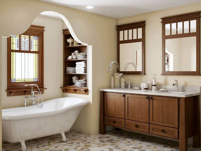 The patterned flooring tiles of this craftsman-style bathroom has gray, white and yellow hues that provide a complex background for the beige walls that are dominated by the wooden vanity with modern designs on its cabinets and drawers.