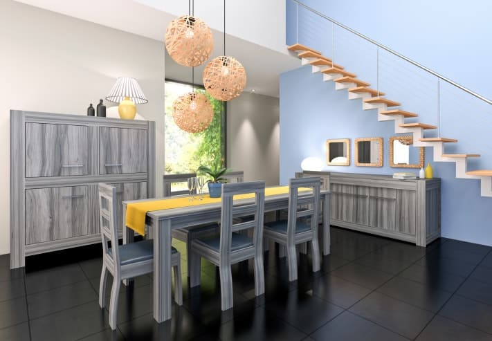 This dining room is furnished with a storage cabinet, buffet table and dining set sporting a cohesive design. It includes spherical pendant lights and framed mirrors mounted on the blue staircase.