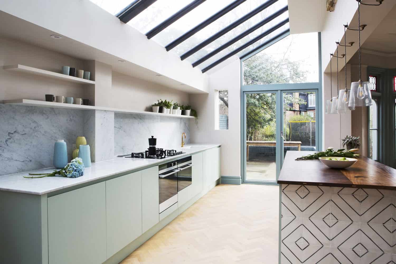 Bespoke kitchen featuring the kitchen island with reclaimed wood worktop and reclaimed tiles.
