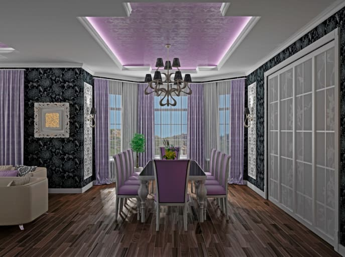 A luxurious-looking dining area featuring elegant black decorated walls and a stunning tray ceiling. The room has a purple accent adding elegance to the area.
