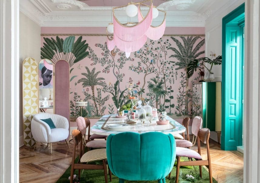 Eclectic dining room featuring stylish hardwood flooring topped by a green rug. The pink jungle-themed wall, along with the pink decorated ceiling add elegance to the room.