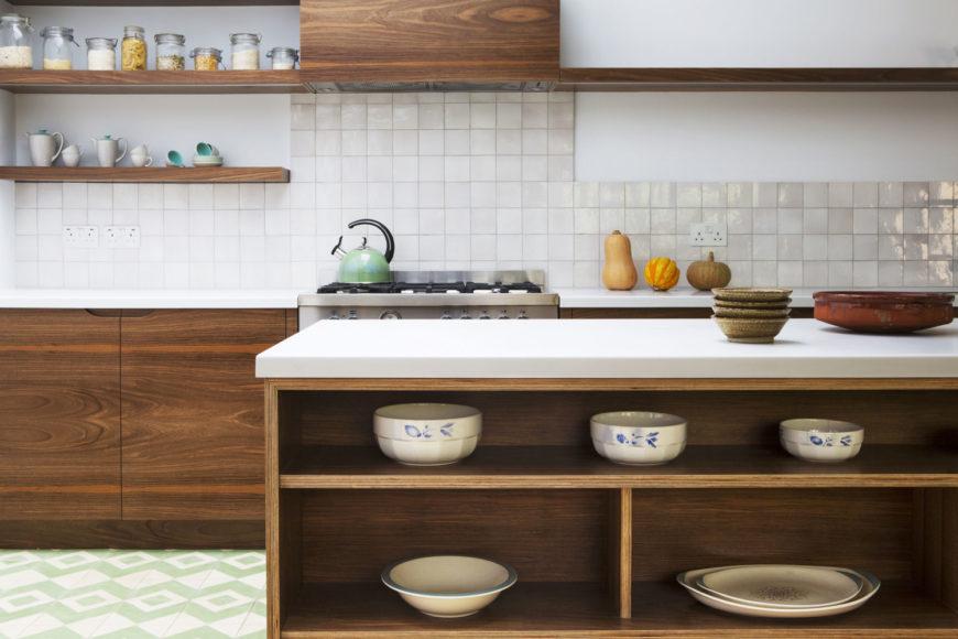 Bespoke kitchen with birch plywood and European walnut veneered cabinets.