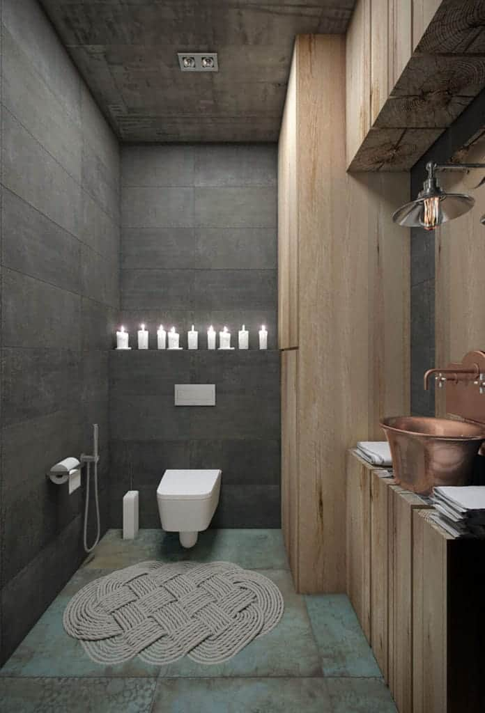 This bathroom is a lovely fusion between the industrial-style elements and some farmhouse-style elements. The industrial-style tone of the light green flooring, gray wall and gray concrete ceiling are complemented by the wooden beams of the vanity.