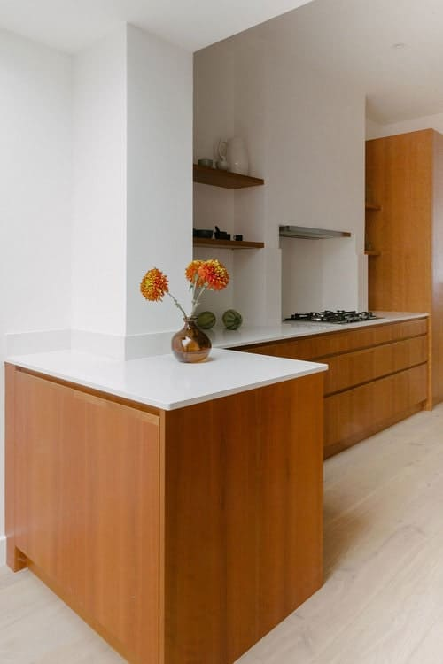 Cherry veneer kitchen with open shelving.