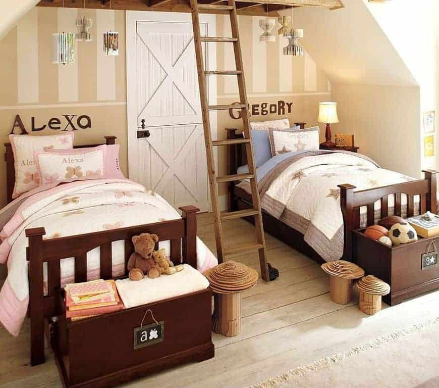 Kids bedroom with a dutch door and rustic ladder situated in between the dark wood beds with storage boxes on its ends. It is designed with hanging decors and wooden mushrooms that sit on wide plank flooring.
