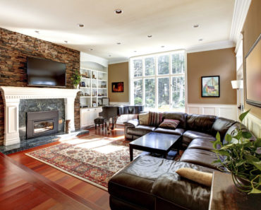 Family room with large leather sectional sofa