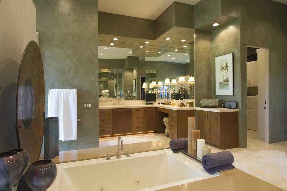 Large modern primary bathroom with a powder desk and a sink counter, along with a drop-in tub and a walk-in shower room.