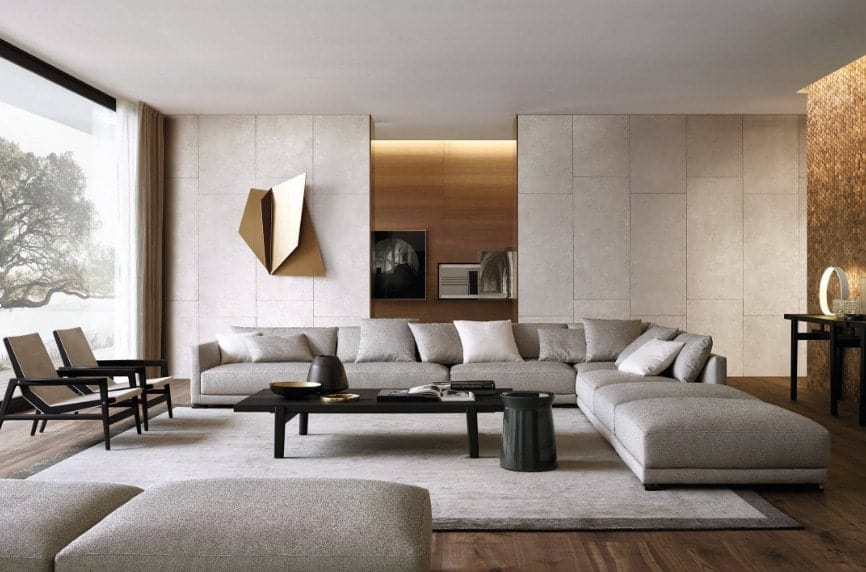 A spacious living area featuring a gray sofa set and a black center table along with a sliding wall covering the TV and other built-in shelving.