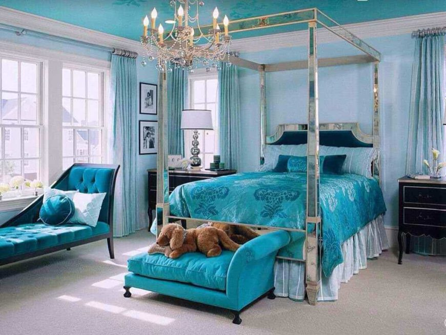 Primary bedroom surrounded by blue walls, blue window curtains and a blue decorated ceiling. The room also has blue seats and a blue bed, lighted by a charming chandelier.