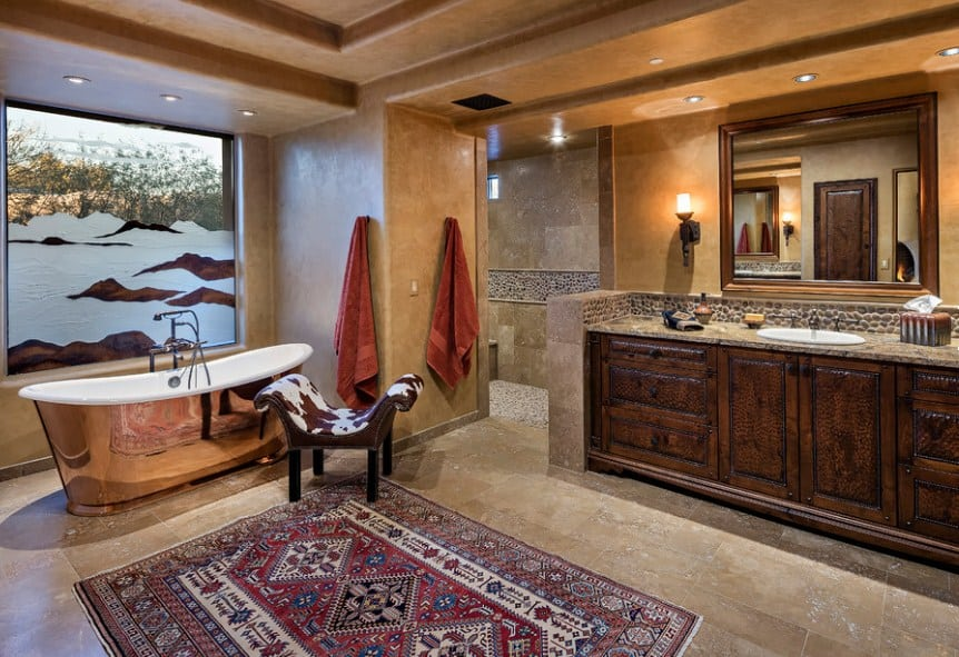 Large southwestern style master bathroom featuring a gorgeous freestanding tub, a walk-in shower room and a stunning tray ceiling.