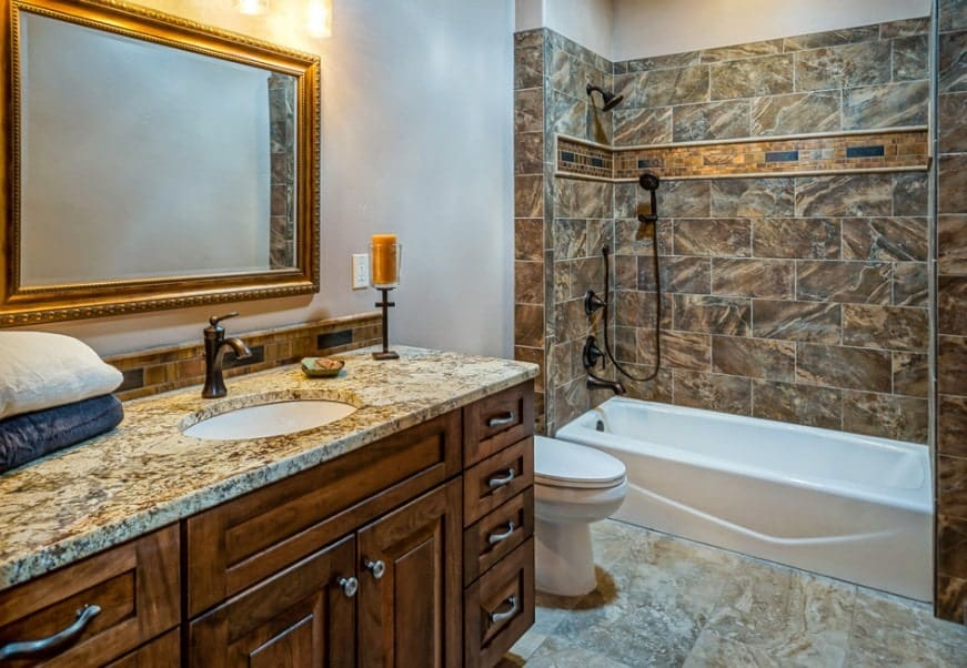 An elegant-looking master bathroom with a classy sink counter and a shower and tub combo.