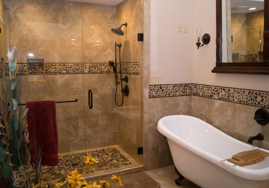 A southwestern primary bathroom with featuring a freestanding tub and a walk-in shower room.