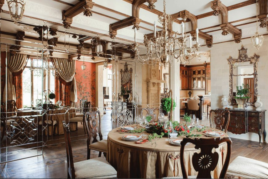 Gorgeous dining room illuminated by a candle chandelier that hung over the cozy dining set. It has a natural wood plank flooring and a stylish mirrored wall which creates a larger visual space to the area.