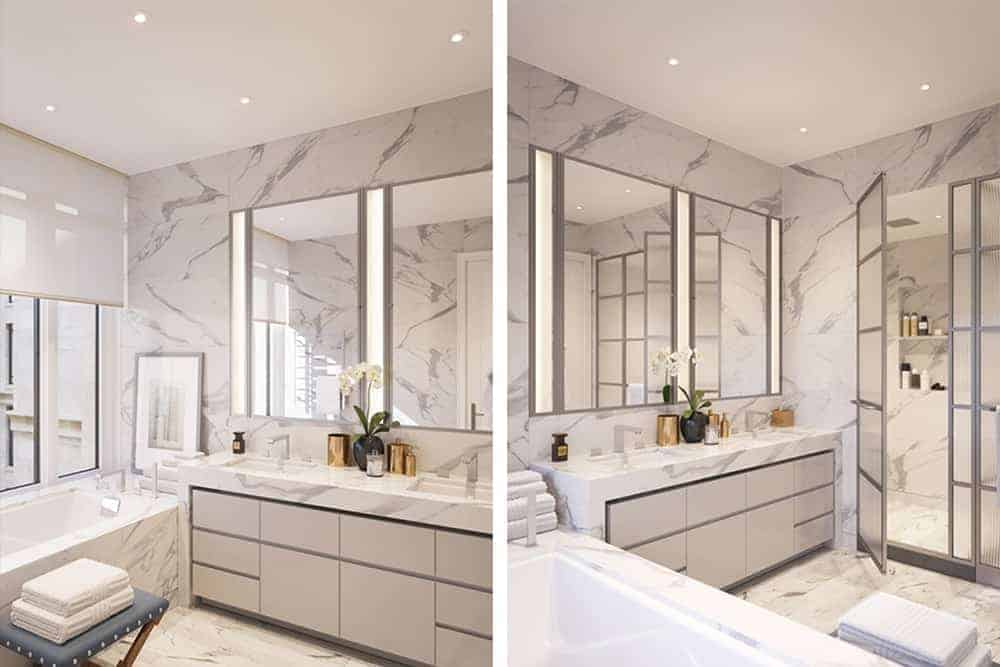 Elegant white master bathroom offers a sleek vanity and deep soaking tub accompanied by a stool and framed wall art. Marble tiles run throughout adding sophistication in the room.