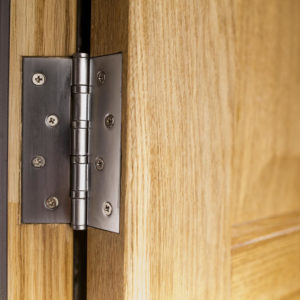 Close up photo of a door hinge