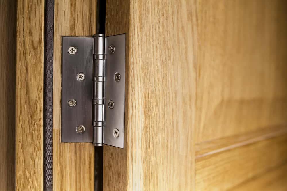 Close up photo of a door hinge