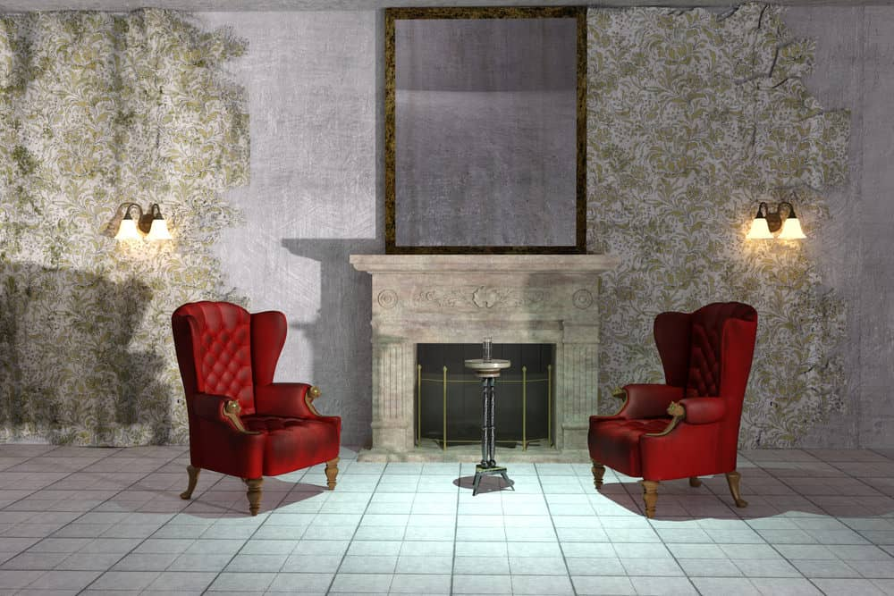 2 red wingback chairs flanking the fireplace