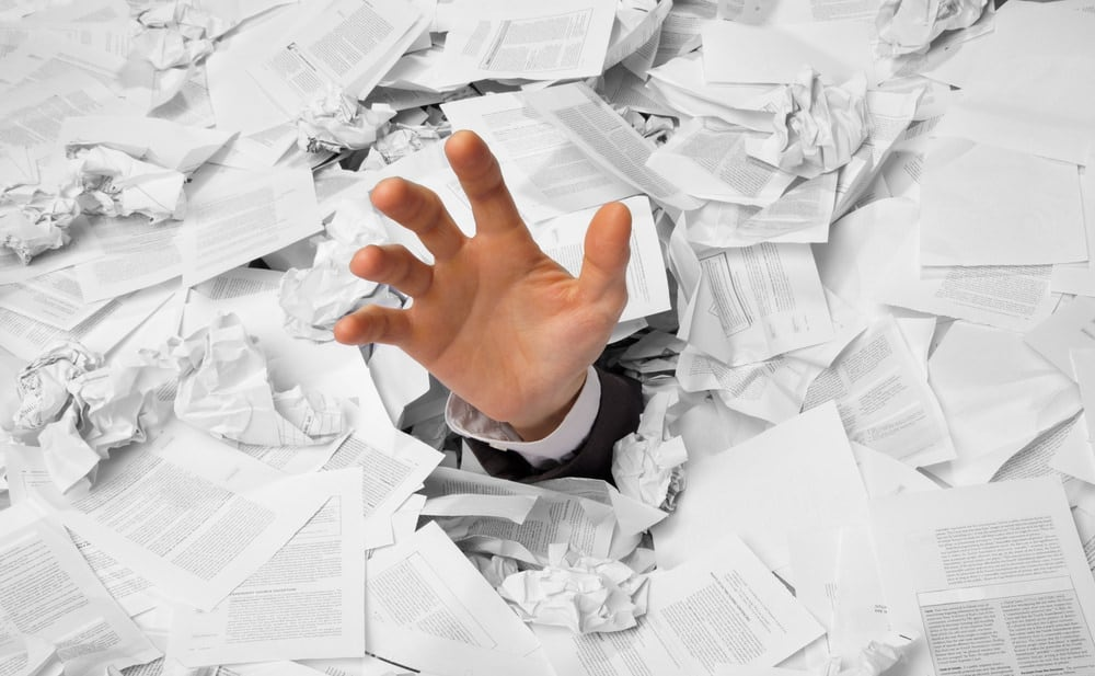 Person drowning in co-op application paperwork