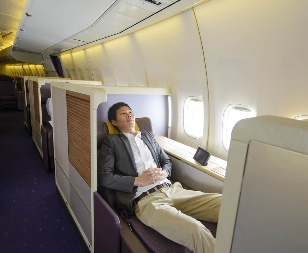 Man flying in luxurious first class on airplane