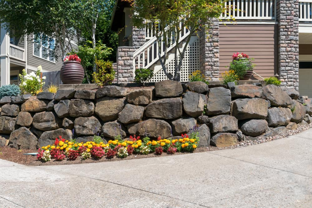 Boulder wall in front yard