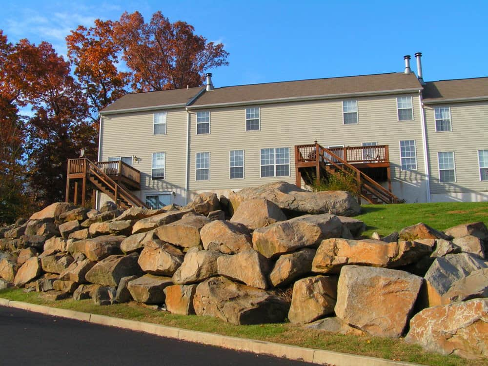 Huge boulders as a retaining wall on residential property