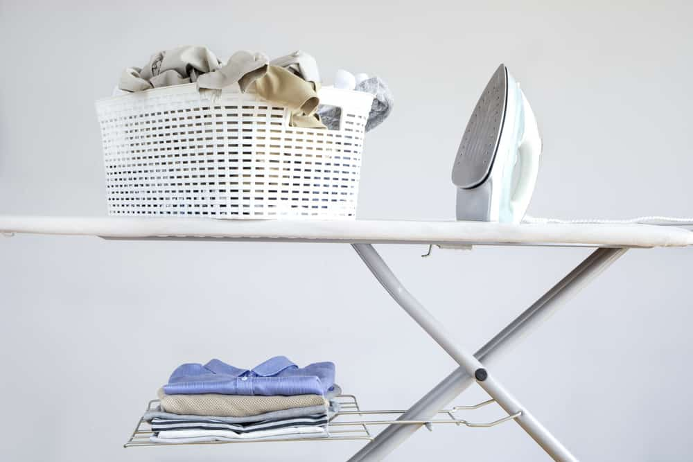 Ironing board with iron