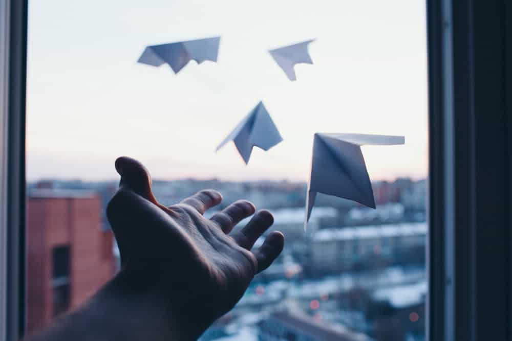 Letting go of paper airplanes out the window