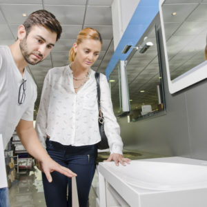 Plumber buying a sink in a home improvement store