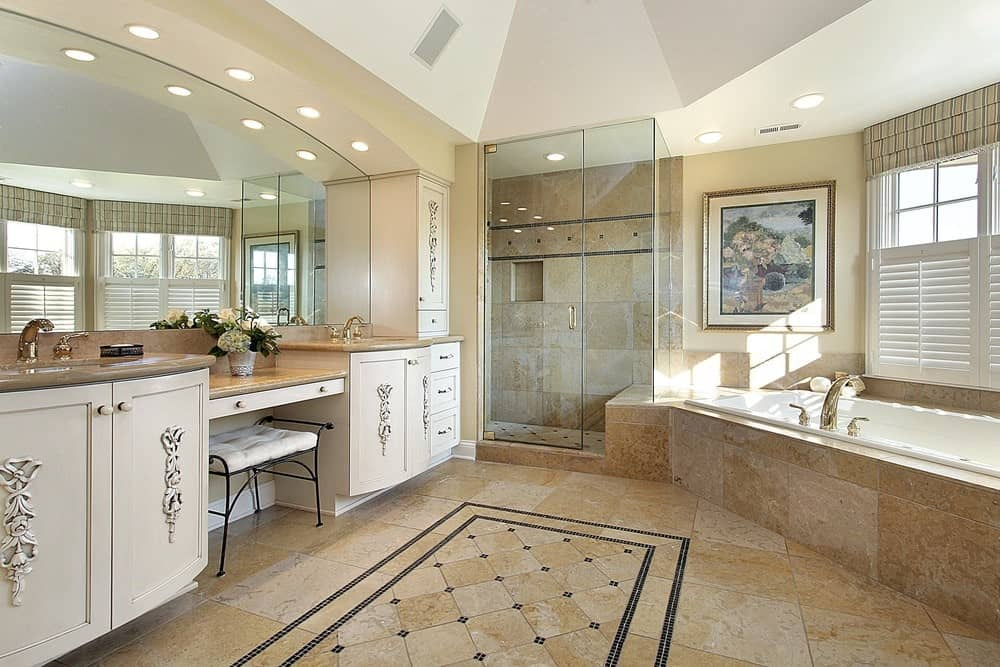 A gorgeous painting above the bathtub adds a nice accent in this primary bathroom with a walk-in shower and dual sink vanity inlaid with ornate carvings.