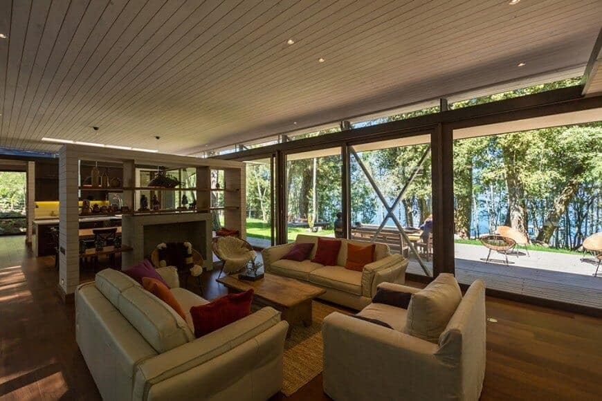 A spacious formal living room boasting a set of classy seats along with a fireplace surrounded by built-in shelves.