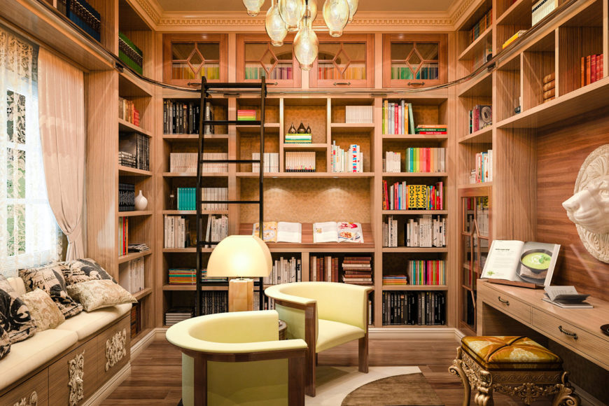 A living space library featuring hardwood flooring and a decorated ceiling. There's a study desk and multiple bookshelves. The room is lighted by a gorgeous chandelier.