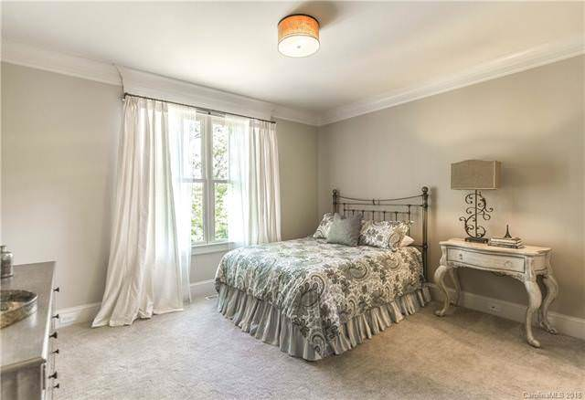 This bedroom has a simple setup of a simple wrought iron bed that matches well with the decorative table lamp on the console table beside the bed that fits well with the light tone of the walls.