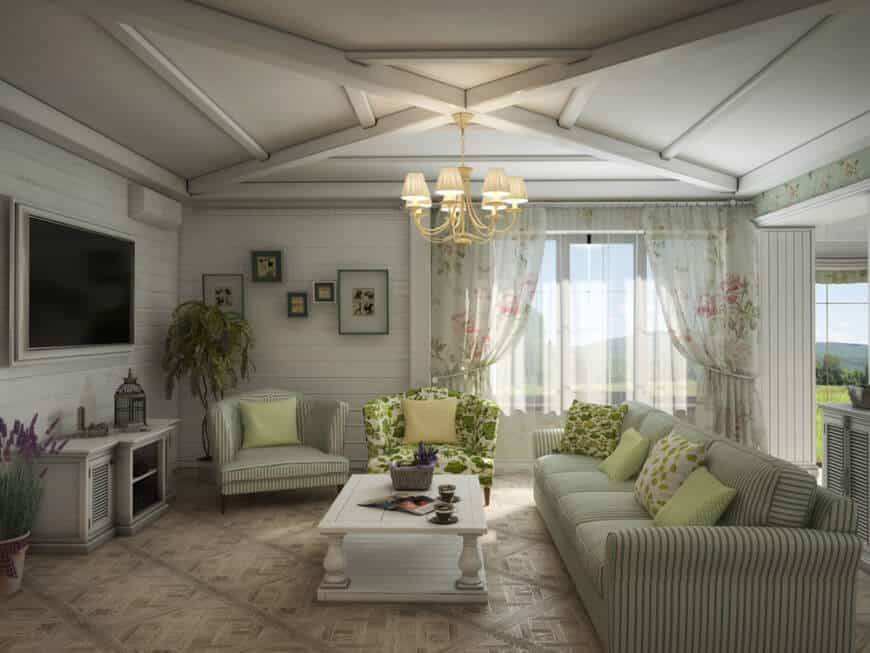 Large Country-style living room featuring a beautifully-designed ceiling, stylish flooring, elegant seats and a large widescreen TV in front of the sofa set.