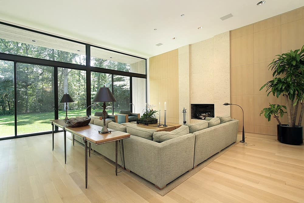 Large modern living room with a large L-shaped sofa set along with a fireplace.