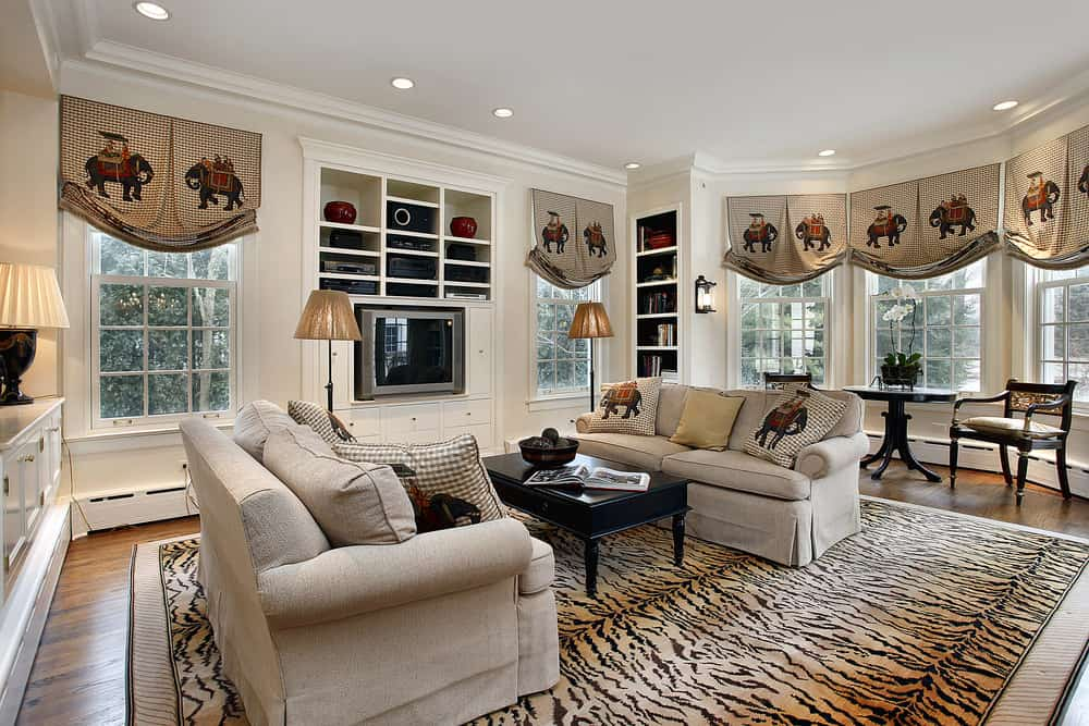 Large living room featuring a gorgeous tiger-print area rug where the sofa set and the center table are situated.