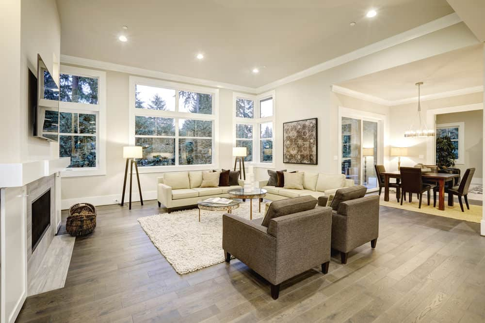 A spacious family living space with a modern sofa set, a fireplace and a flat-screen TV on top of it.