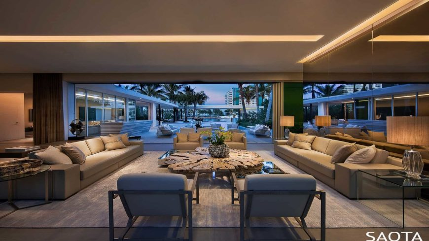 Contemporary formal living room boasting a pair of modern sofa set along with a stylish center table under the breathtaking ceiling.