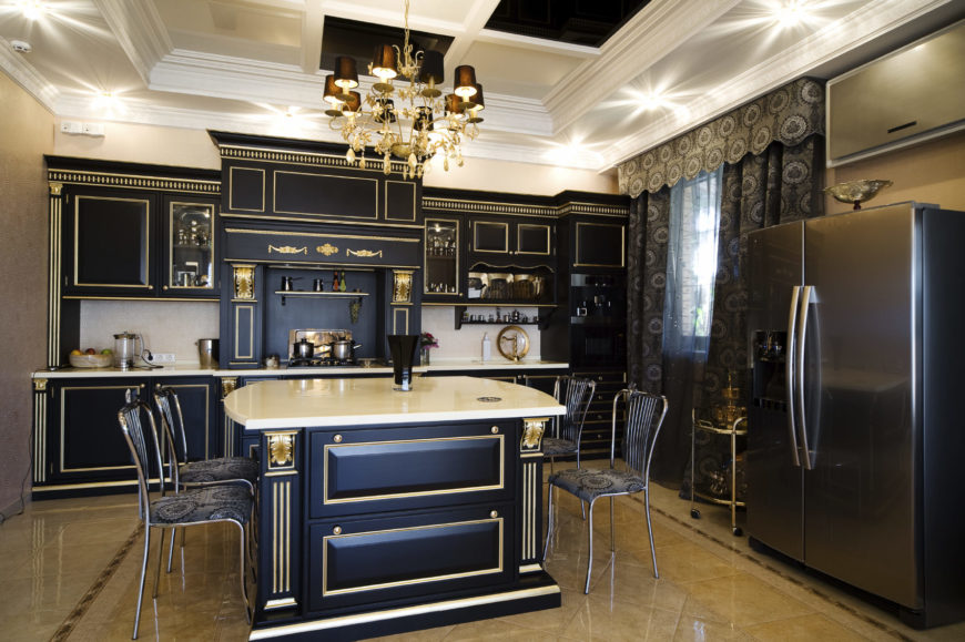 A single wall kitchen boasting elegant decorations on its cabinetry and counter that matches the center island's gorgeous design. The ceiling looks absolutely classy as well, lighted by a stunning chandelier.