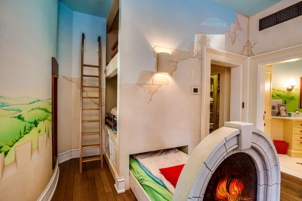 This is a charming kids' bedroom with a large built-in structure that houses bunk beds with a third pull-out bed at the bottom. These are complemented by the hardwood flooring, beautiful wall murals and warm yellow lighting. Images courtesy of Toptenrealestatedeals.com.