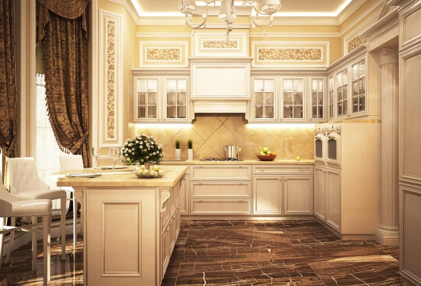 Warm kitchen with black marble flooring and full height windows dressed in classy drapes and valances. It includes white cabinetry and breakfast island paired with white counter chairs.