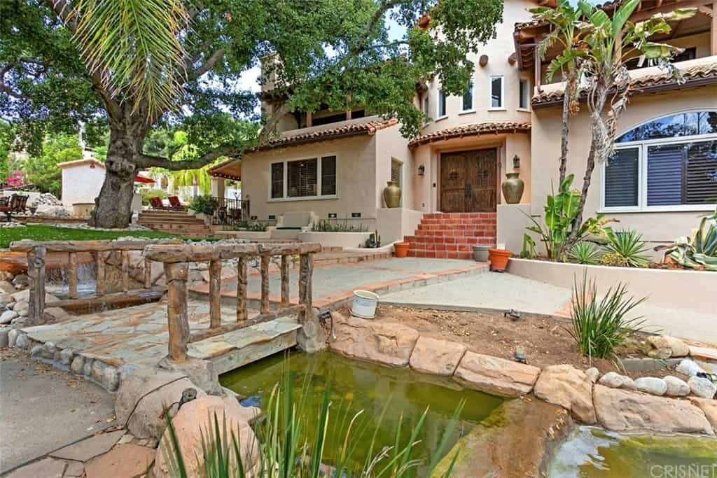 Moonlight Hacienda with Thick Adobe Archways, Distressed Beamed Ceilings, and Saltillo Pavers
