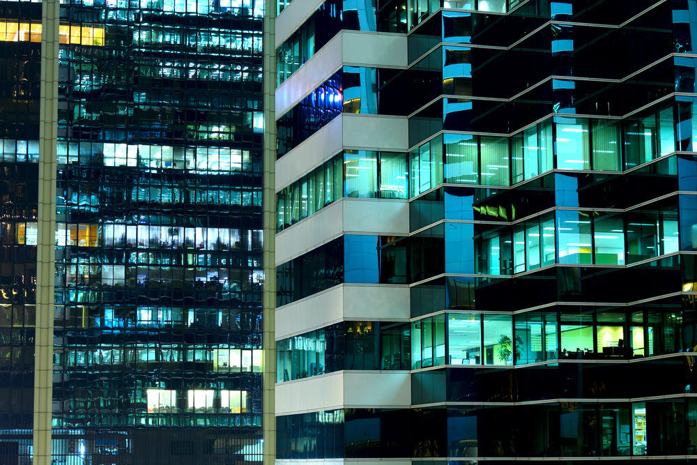 Glass office towers at night