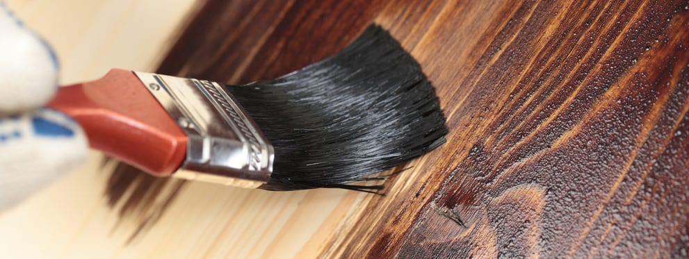 Brush staining wood
