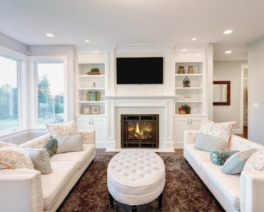 Elegant living room with white sofas